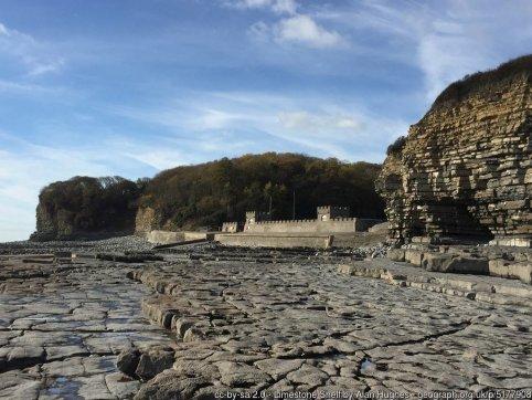 Limestone Shelf Limestone shelf at St.Donat's bay. View towards St.Donat's lifeboat station.