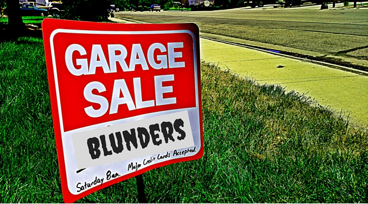 "Garage Sale sign with the word ""Blunders"" featured. Red Garage sale sign in quiet neighborhood."