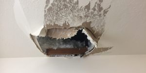 hole in ceiling from water damage