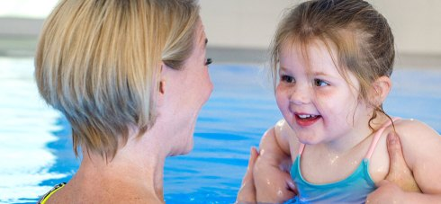 Mum and daughter at Wallops Wood playing in the pool