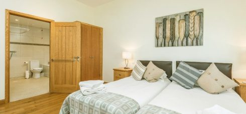 Wallops Wood Cottage Hedgehunter has a wet room for accessible guests