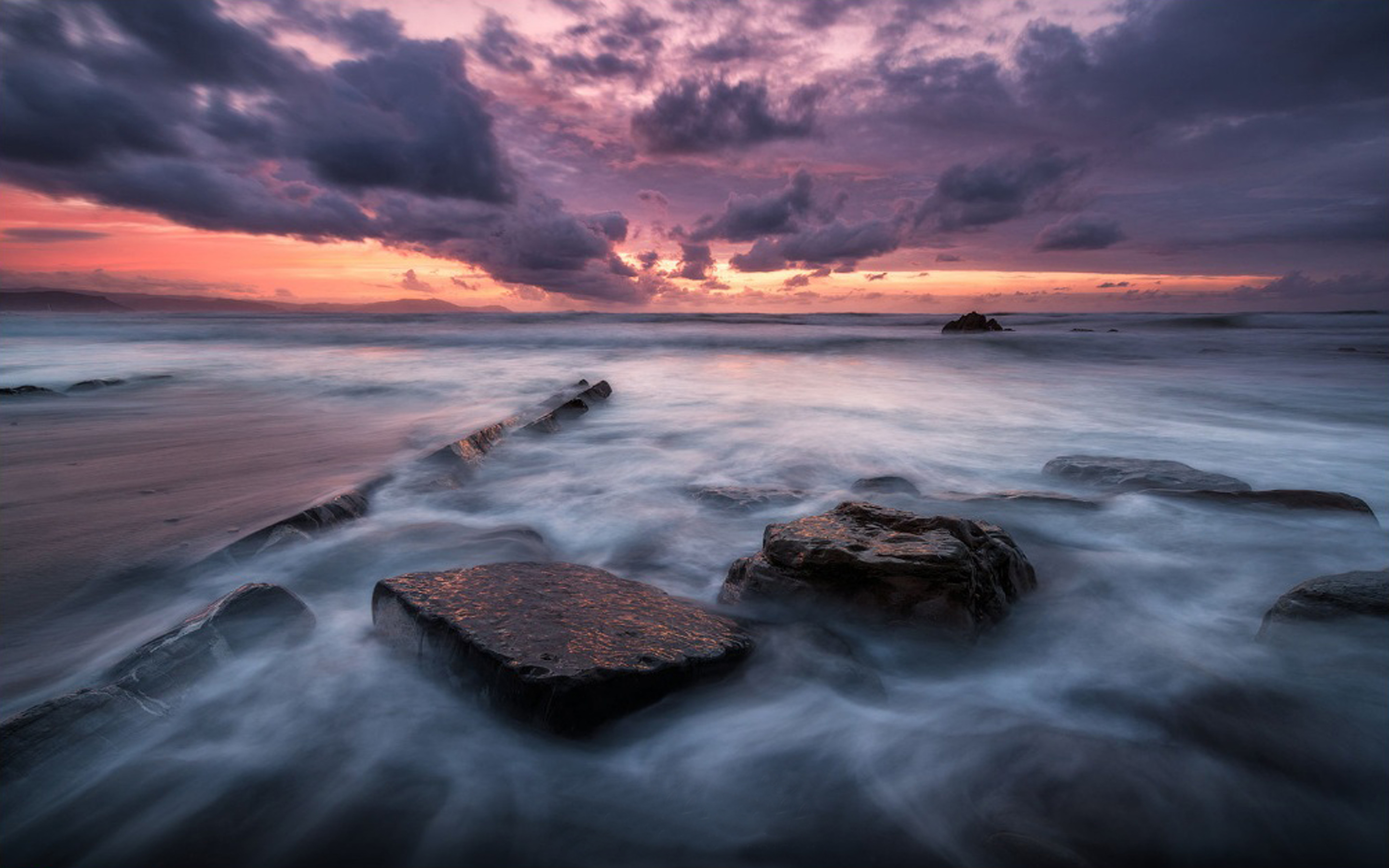 Sea Coast With Rocks Waves Dark Sky With Clouds Red