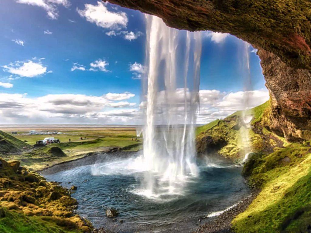 Seljalandsfoss Waterfall Is Located In The Southern Region