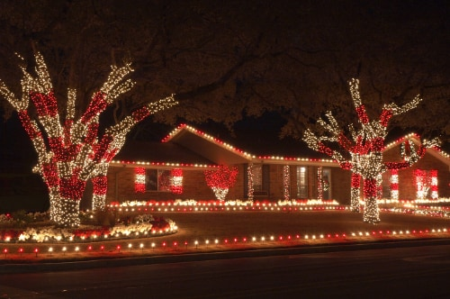 Home decorated with red and white Christmas lights