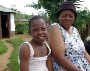 Healthy again: HIV-AIDS orphan Mbali Mdlovu, with her gogo (granny).