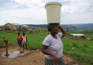 Water is pumped by hand and carried back home.