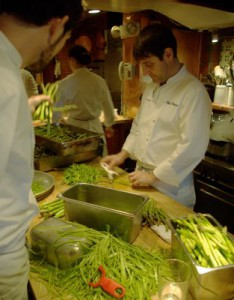 Chef Jerome Waag peels in the Chez Panisse kitchen.