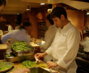 Chef Jerome Waag cuts veggies in the Chez Panisse kitchen, Berkeley.