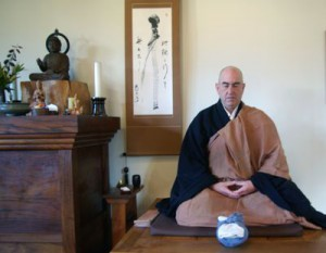 Hozan Alan Senauke waits to demo oryoki in the Berkeley Zen Center zendo.