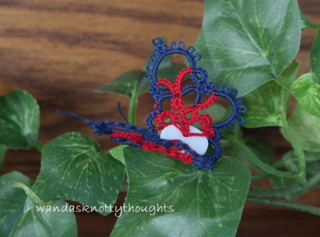 Tatted button butterfly in blue and red ready to fly away on wandasknottythoughts