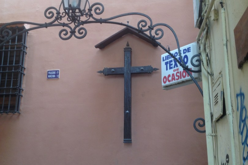 Malaga street scene catholic cross