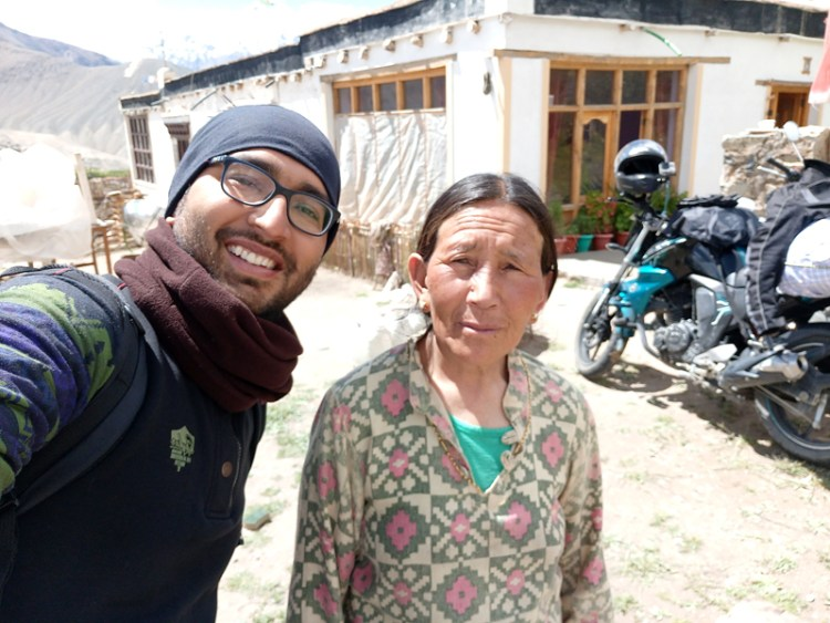 a male with a old woman in the mountains