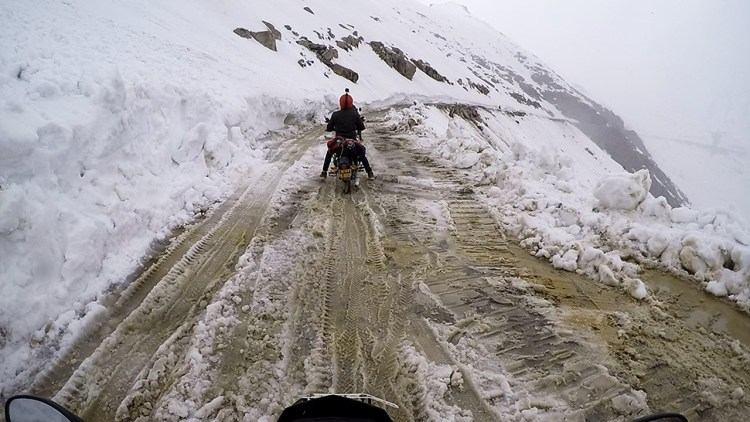 A biker driving on icy road