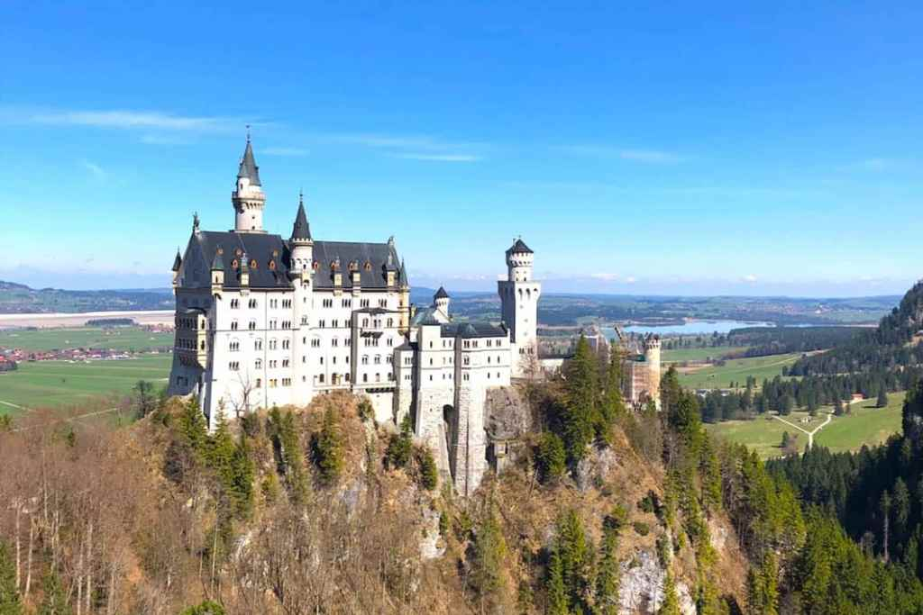 Neuschwanstein Castle Complete Guide. Visit Neuschwanstein Castle- this guide will show you how to see the fairytale castle up close! #neuschwanstein #neuschwansteincastle #disneycastle #fairytalecastle #castle #germany #traveltips #travelblog #wanderingbird #roadtrip #castles #fairytale #disney