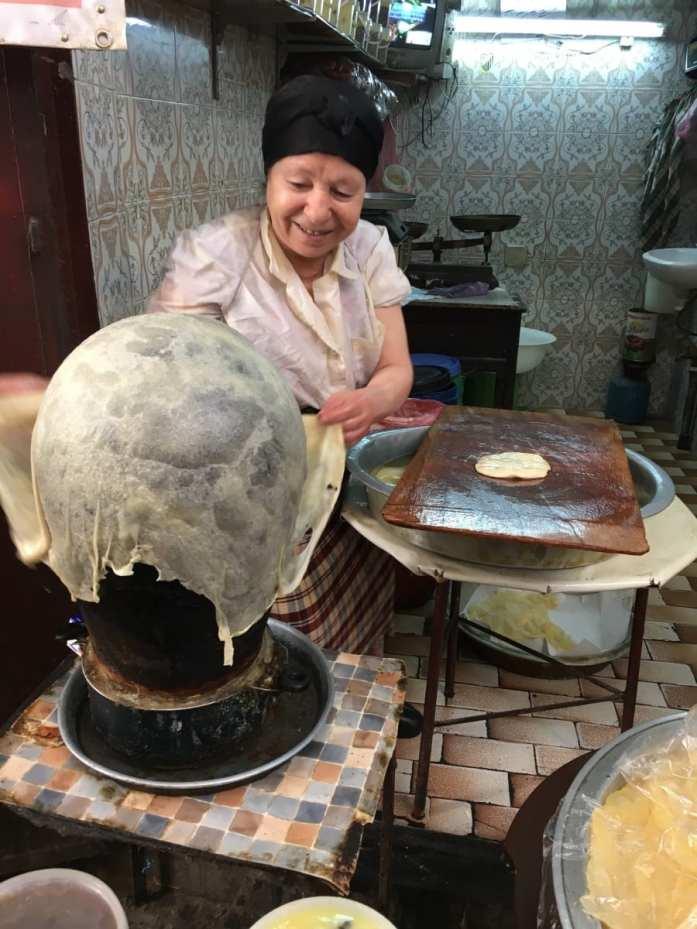 Street food vendor making Morocco pancakes