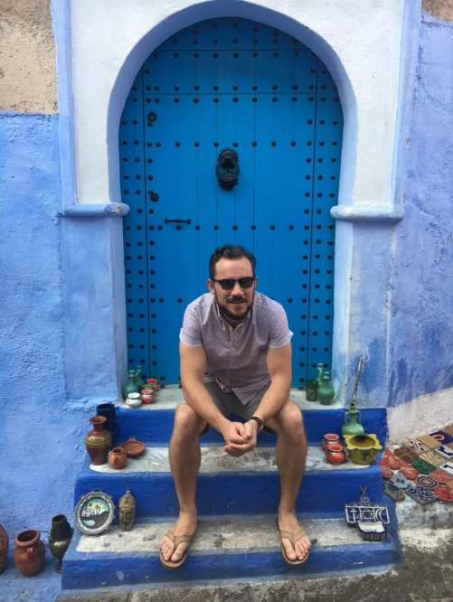 Sitting on the steps of a house in Chefchaouen