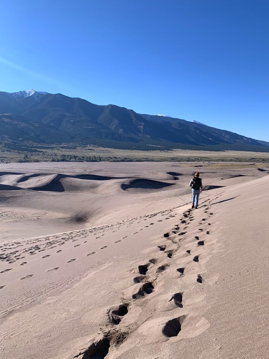 Jesse walking on the sand dunes