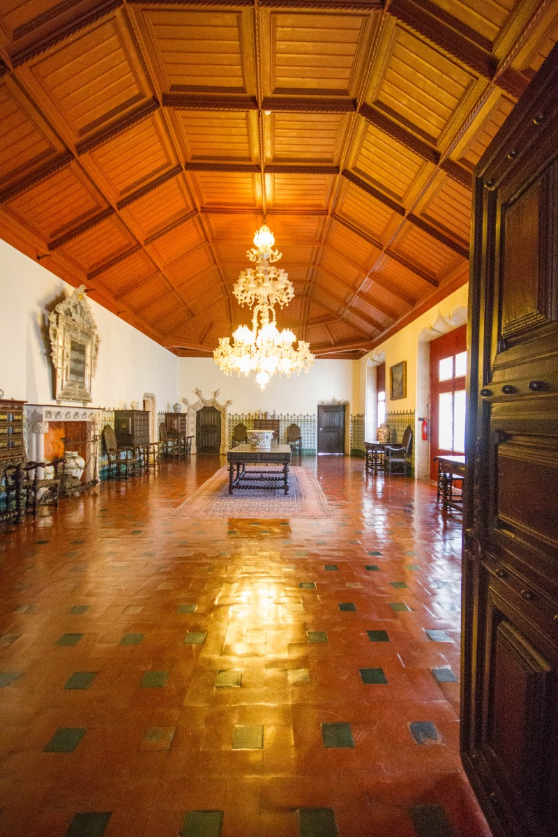 Great hall in the Sintra National Palace with a stunning chandalier and intricate wood ceiling - Sintra, Portugal