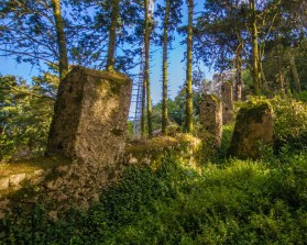 Ruins and posts line the walkway to the Moorish castle in Sintra, Portugal