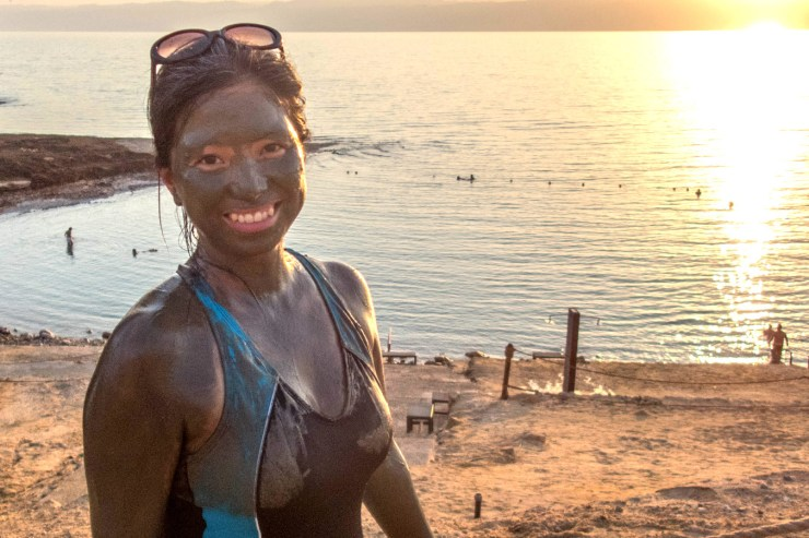 woman smiling in front of the Dead Sea