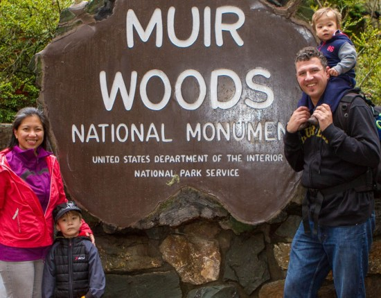 Family in front of sign at Muir Woods National Monument