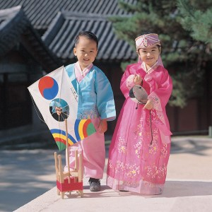 Two young japanese children in traditional dress. Travel with kids helps families notices similarities between cultures and celebrate the differences