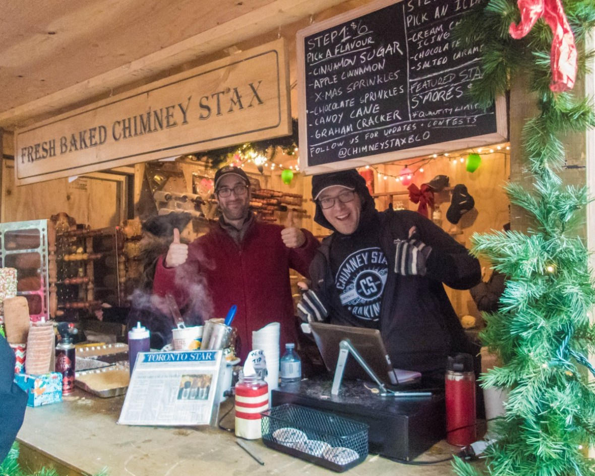 The staff at the Chimney Stax booth at the Toronto Christmas Market in the Distillery District