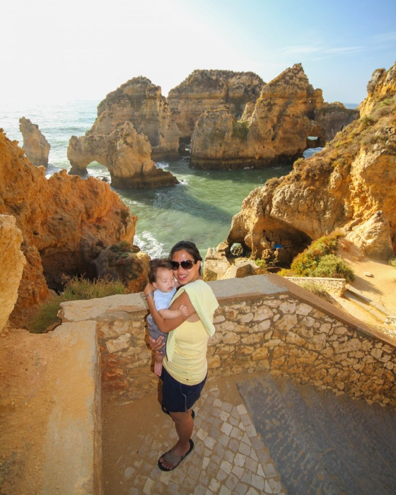Woman and son in front of ocean cliffs