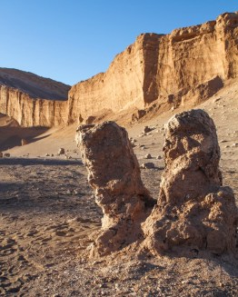 two tall rocks jut out from the earth in the Atacama Desert