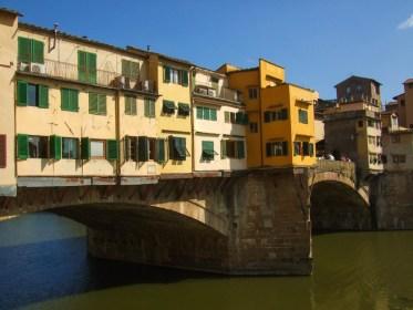 A bridge in Venice Italy covered in small apartments - Lost in Venice