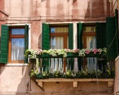 Flowers line the window sills of colourful buildings in Venice, Italy - Lost in Venice