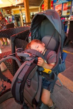 Young child in a kid carrier fast asleep - Deuter Kid Comfort III