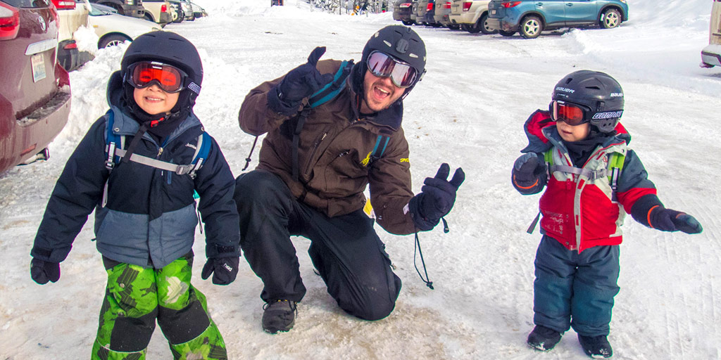 A young family in ski gear ready to hit the hills