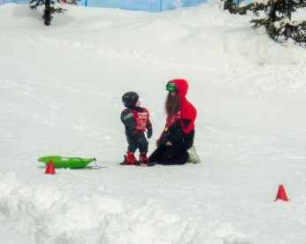 Little boy getting ski lesson - Learning to Ski at Kelowna's Big White