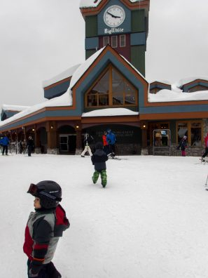 Children playing in a ski resort village - Learning to Ski at Kelowna's Big White