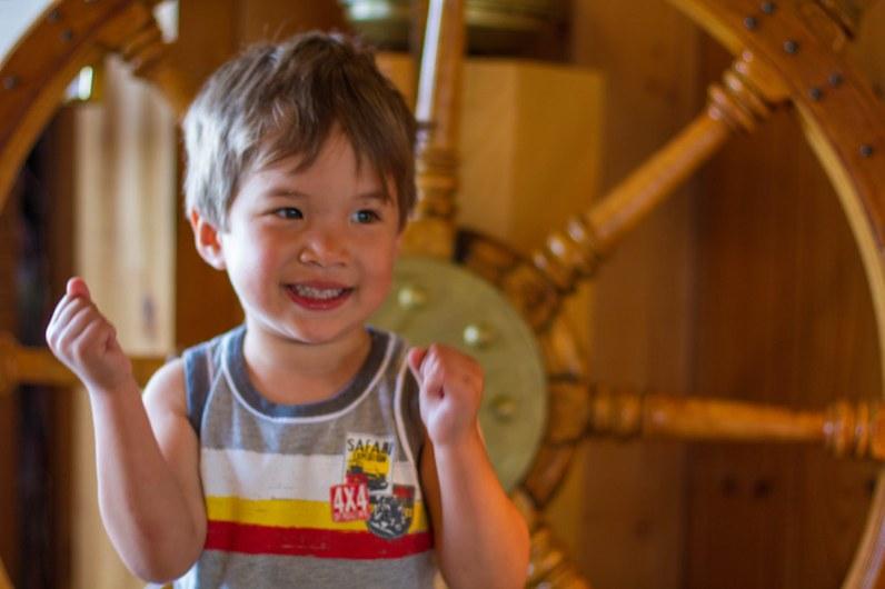 A young boy explores the Restaurant La Maison Pecheur in Perce Quebec