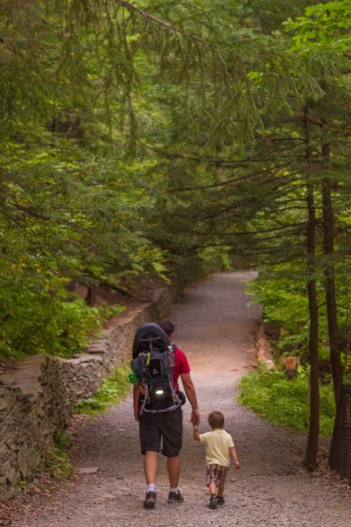 Father and boy walking on the Indian Trail in Wakins Glen State Park.