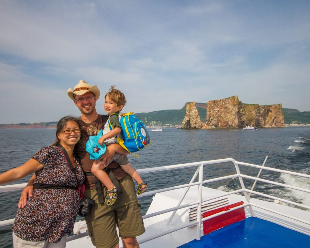 Family poses on a boat cruise of the A must do in the Gaspé Peninsula: Bonaventure Island and Percé Rock.