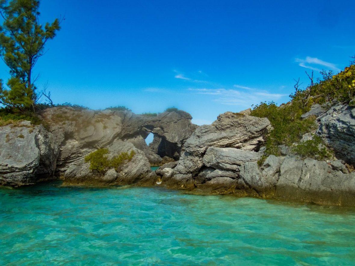 Stunning grey rocks frame emerald blue waters in a Bermuda cove - Boating in Bermuda