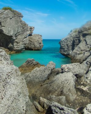 Stunning grey rocks frame emerald blue waters in a Bermuda cove - Boating in Bermuda