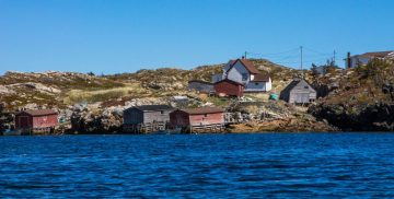 a small fishing village sits on the shores of Newfoundland - Icebergs in Newfoundland