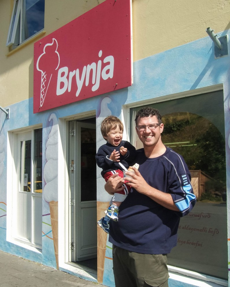 A father and young boy smile outside an Ice Cream shop in Akueyri, Iceland - An Epic 14 Day Iceland Itinerary