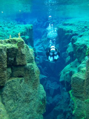 A scuba diver in the Silfra fissure - An Epic 14 Day Iceland Itinerary