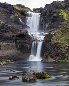 A stunning waterfall tumbles into soft water - An Epic 14 Day Iceland Itinerary