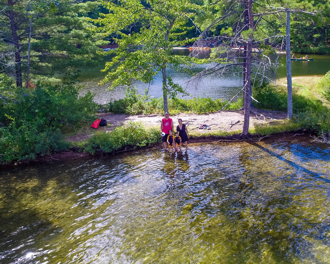 Aerial view of a family smiling at the tip of a lagoon - Top things to do in Bon Echo Provincial Park