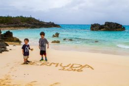 Boys playing in the sand at Long Bay Beach in Bermuda