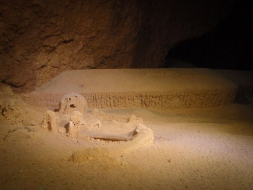 A skeleton of a young girl lies inside a cave in Belize - caves you can visit with kids