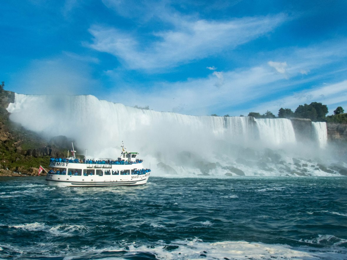 The Maid of the Mist boat tour motors beneath the American Falls - Exploring Niagara Falls
