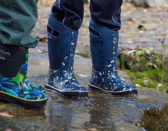 Closeup of children wearing bogs snow boots - Bogs kids winter snow boots