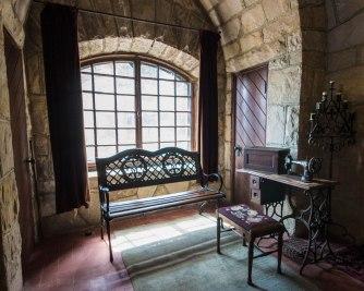 Antique Singer sewing machines adorn a room in Singer Castle.